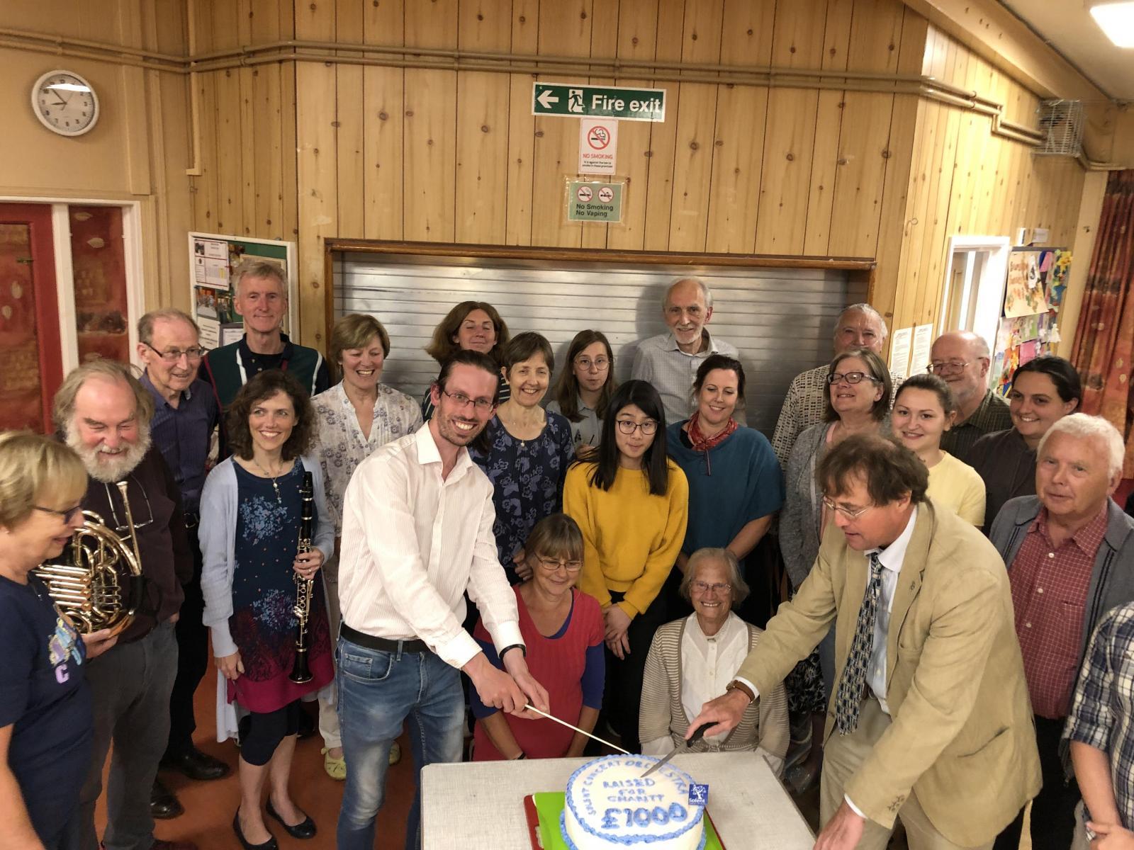 M.D. Simon Wilkins and Chairman Tim Leighton cut the celebratory cake